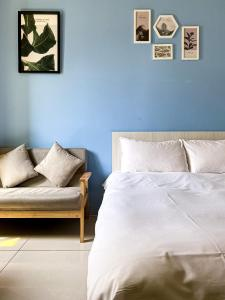 A bed or beds in a room at Adagio Hostel