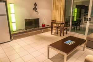 A television and/or entertainment center at Marina View Apartment