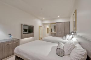 ダクストン ホテル パースにあるベッド