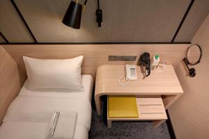 A bed or beds in a room at Aerotel Extension, Klia2
