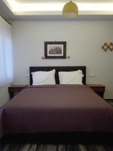 Ένα ή περισσότερα κρεβάτια σε δωμάτιο στο Hotel Lego