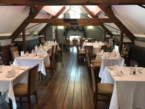 A restaurant or other place to eat at The Barns Hotel
