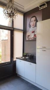Een keuken of kitchenette bij Residenz Stadslogement