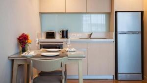 A kitchen or kitchenette at Amari Residences Bangkok