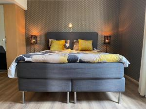 A bed or beds in a room at Dune Apartment