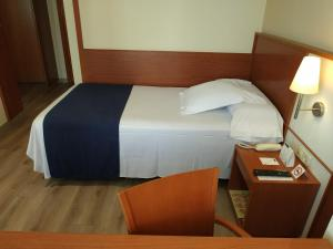 A bed or beds in a room at Sorolla Centro