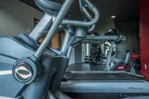The fitness center and/or fitness facilities at Ramada by Wyndham Ottawa On The Rideau