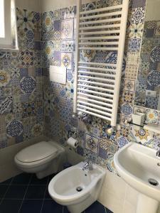 Um banheiro em Albergo Oasi