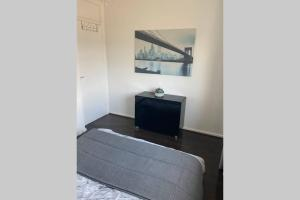 A television and/or entertainment center at Spacious One Bedroom Flat