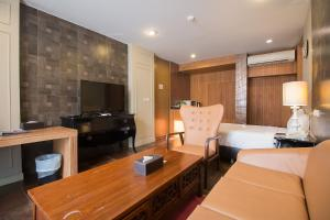 A television and/or entertainment center at Sukhothai Treasure Resort & Spa