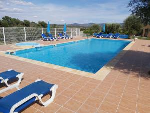 The swimming pool at or near Cidadelhe Rupestre Turismo Rural