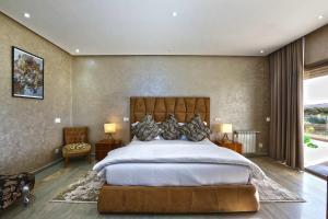 Un ou plusieurs lits dans un hébergement de l'établissement Mountains Palace Marrakech