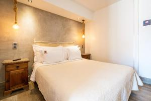 A bed or beds in a room at Villas D. Dinis - Charming Residence (adults only)