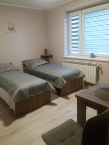 Łóżko lub łóżka w pokoju w obiekcie Ośrodek Wypoczynkowy Jan