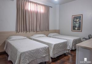 A bed or beds in a room at Hotel Santa Maria