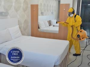 A bed or beds in a room at Copa Sul Hotel
