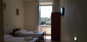 Cama ou camas em um quarto em Villa Monte Mario