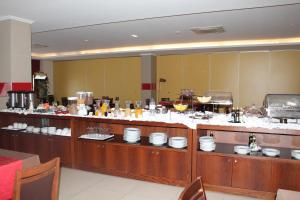 A restaurant or other place to eat at Palace Hotel & SPA Termas do Bicanho