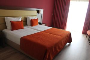 A bed or beds in a room at Palace Hotel & SPA Termas do Bicanho
