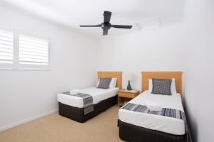 A bed or beds in a room at Offshore Noosa Resort