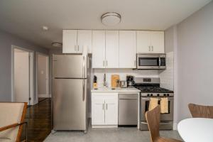 A kitchen or kitchenette at The High Line Chelsea 30 Day Rentals