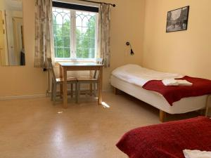 Säng eller sängar i ett rum på Leksands Folkhögskola