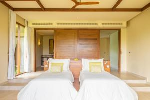 A bed or beds in a room at Fusion Resort Phu Quoc - All Spa Inclusive