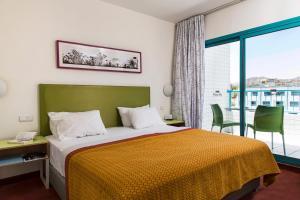 Een bed of bedden in een kamer bij Nova Like Hotel - an Atlas Hotel