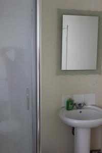 A bathroom at Olympia Hotel