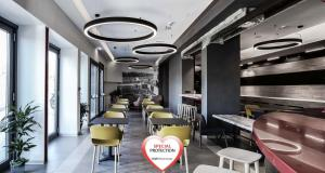 A restaurant or other place to eat at Best Western Hotel Corsi