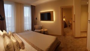 Ein Bett oder Betten in einem Zimmer der Unterkunft Hotel Clement