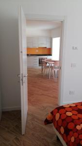 Kuchyň nebo kuchyňský kout v ubytování Hotel Marchi