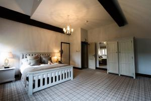 A bed or beds in a room at Weston Hall
