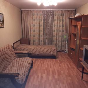 Кровать или кровати в номере Apartment na Smirnova