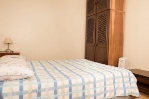 A bed or beds in a room at Apto. CORAÇÃO DE GRAMADO 80 m da Rua Coberta.