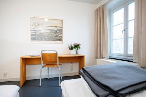 En eller flere senger på et rom på Falstadsenteret