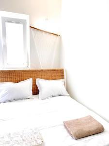 Łóżko lub łóżka w pokoju w obiekcie Sopockie Santorini