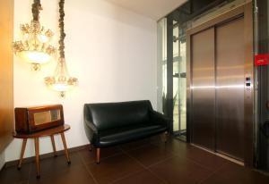 Ein Sitzbereich in der Unterkunft Moderna