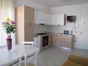 Kuchyň nebo kuchyňský kout v ubytování Residence Gianka