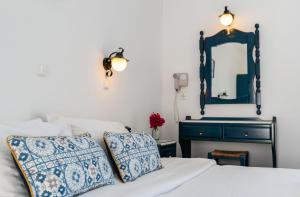 A bed or beds in a room at Adonis Hotel Studios & Apartments