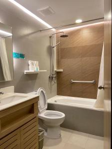 A bathroom at Microtel by Wyndham Tarlac