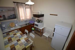 Η κουζίνα ή μικρή κουζίνα στο Jimmy's Apartments