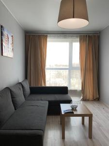 Гостиная зона в Apartment Aquarelle 258