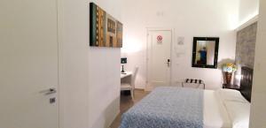 Letto o letti in una camera di B&B Abatjour - ambiente sanificato - test antilegionella assolto