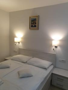 Posteľ alebo postele v izbe v ubytovaní Captain's Club