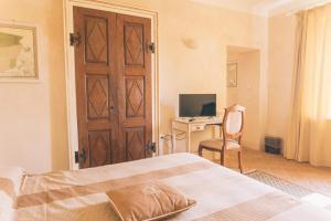 Letto o letti in una camera di Hotel Relais Il Borgo