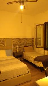 A bed or beds in a room at Casa Dori