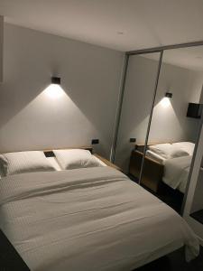 A bed or beds in a room at studio en hyper centre de dole