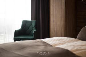 A bed or beds in a room at Hotel Eurobus