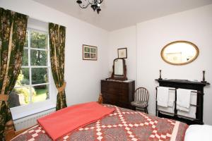 A bed or beds in a room at Crannagael House